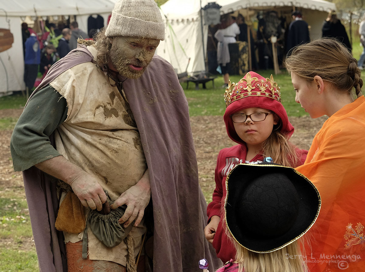 The Mud Man, left, blessing many people at Riverssance in Sioux City, Iowa, Saturday, Oct. 3, 2015. (Photo by Jerry L Mennenga)